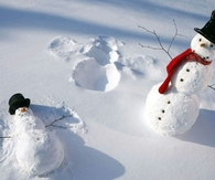 Snowman making snow angels