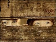 Kids Peeking Through Fence