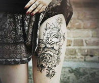 Thigh high rose tattoo