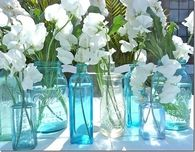 Mason Jars Filled with White Flowers