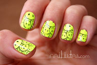 Neon green smiley face nails