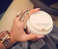 Gold glam rings and stiletto nails