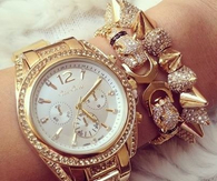 Gold diamond watch and bracelets