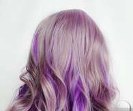 Blonde and purple curly hair