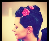 Braided updo with roses