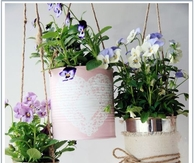 Old cans into flower pots