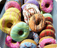 Dozen of sweet donuts