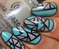 Turquoise and grey aztec nails